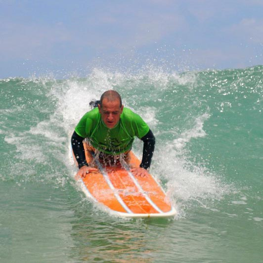 Claudy Robin surfe